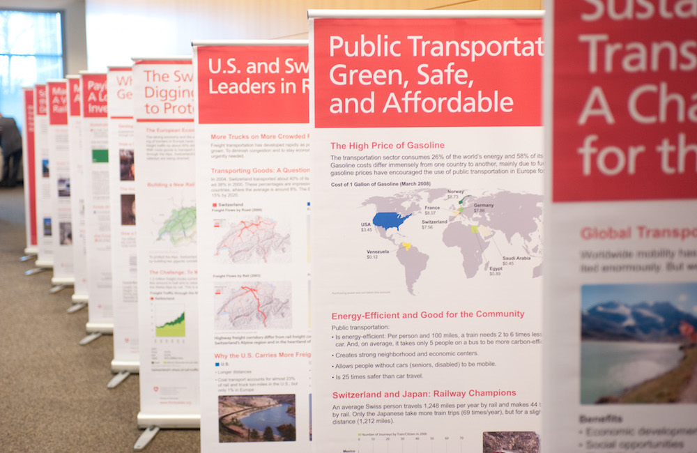 Several research posters displayed in a row.